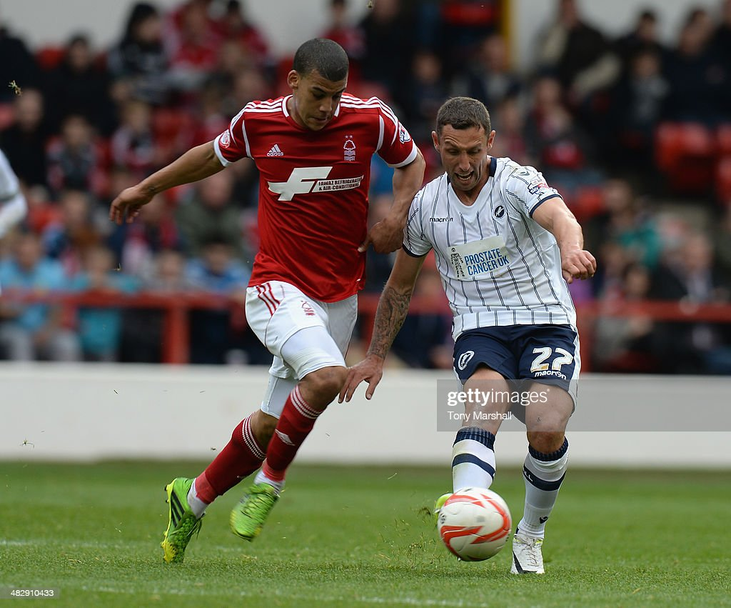 Lee Peltier of Nottingham Forest tackles Scott McDonald of Millwall during the Sky Bet Championship match between Nottingham Forest and Millwall at...