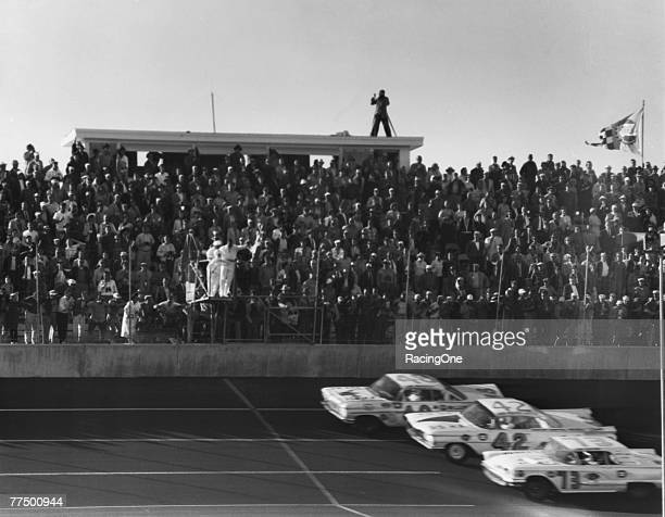 Lee Petty driver of the Oldsmobile races to the line against Johnny Beauchamp driver of the Holman Moody Ford during the first 1959 Winston Cup...