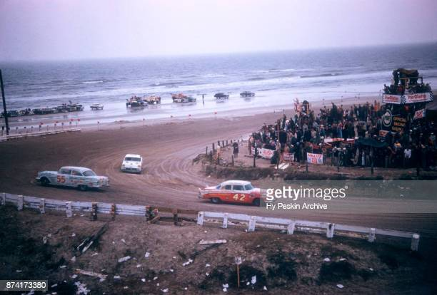 Lee Petty in the Dodge car races along the beach as Junior Johnson in the Pontiac car spins out during the Daytona Beach and Road Course on February...