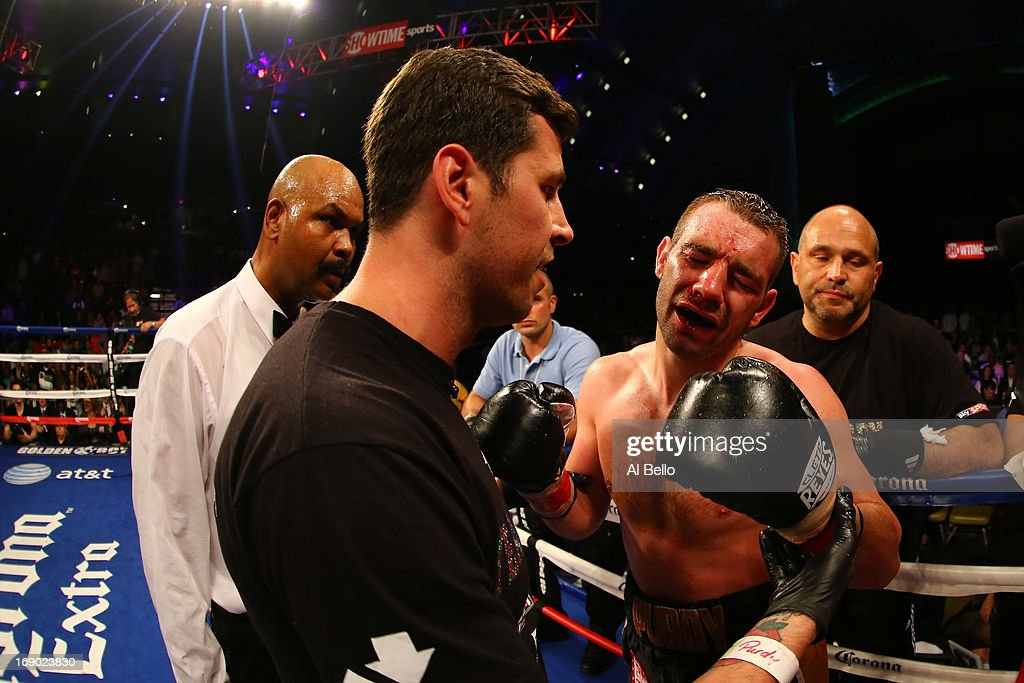 Lee Purdy argues with his corner after they stopped the fight in the seventh round against Devon Alexander during their IBF Welterweight Title fight at Boardwalk Hall Arena on May 18, 2013 in Atlantic City, New Jersey.