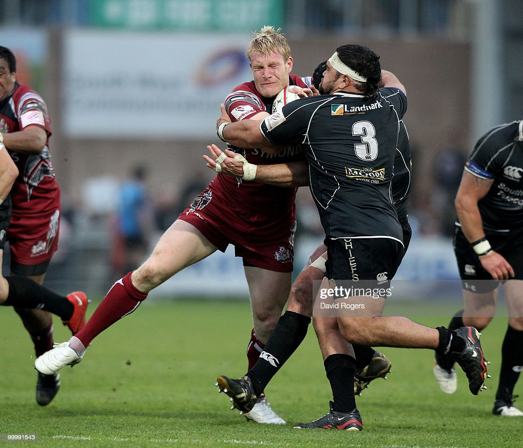 Lee Robinson of Bristol is tackled by Hoani Tui during the Championship playoff final match, 1st leg between Exeter Chiefs and Bristol at Sandy Park on May 19, 2010 in Exeter, England.