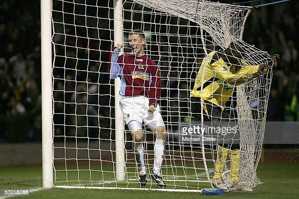 Lee Roche of Burnley celebrates the own goal scored by Djimi Traore of Liverpool during the FA Cup third round match between Burnley and Liverpool at...