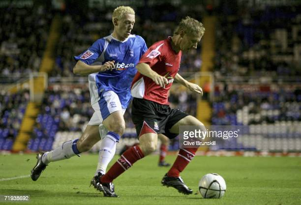 Lee Roche of Wrexham in action with Mikael Forssell of Birmingham City during the Carling Cup second round match between Birmingham City and Wrexham...