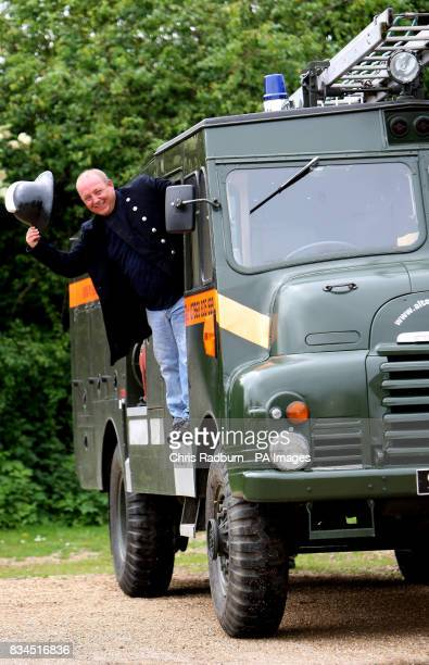 Lee Russell from Holywell St Ives Cambridgeshire leans out of his Green Goddess fire engine after transforming it into a luxury limousine