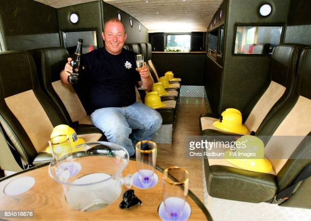 Lee Russell from Holywell St Ives Cambridgeshire pops the champagne inside his Green Goddess fire engine after transforming it into a luxury limousine