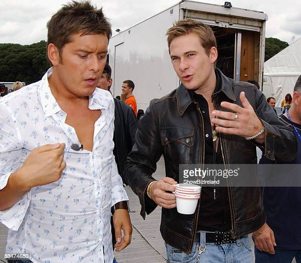 Lee Ryan and Brian Dowling talk backstage during 'O2 in the Park' in Phoenix Park on August 27 2005 in Dublin Ireland