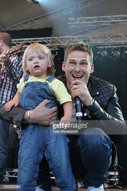Lee Ryan and his son perform during Twenty Ten Live at Hanley Park on June 19 2010 in Stoke on Trent England