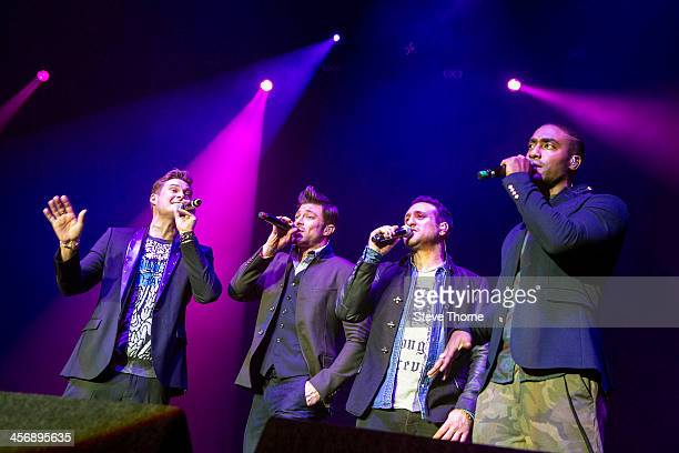 Lee Ryan Duncan James Anthony Costa and Simon Webbe of Blue perform on stage at LG Arena on December 15 2013 in Birmingham United Kingdom