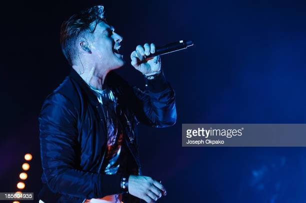 Lee Ryan of Blue performs on stage at Hammersmith Apollo on October 22 2013 in London England