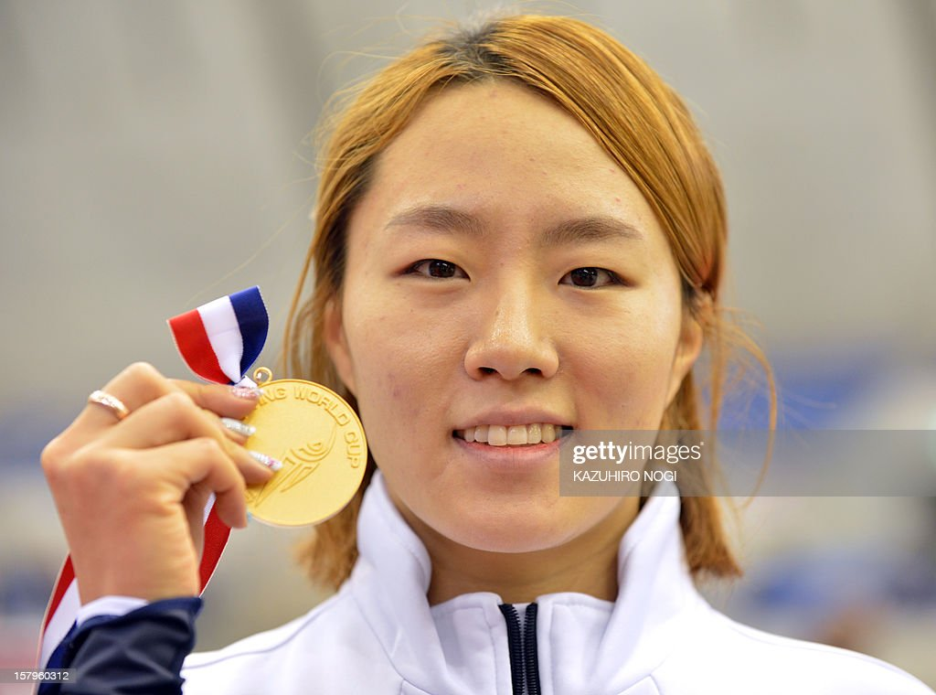 Lee Sang-Hwa of South Korea shows her gold medal during the awards ceremony for the women's 500 meters competition at the World Cup speed skating event at the Nagano M-Wave ice arena on December 8, 2012. Lee clocked the fastest time of 37.63 seconds for the top podium spot.