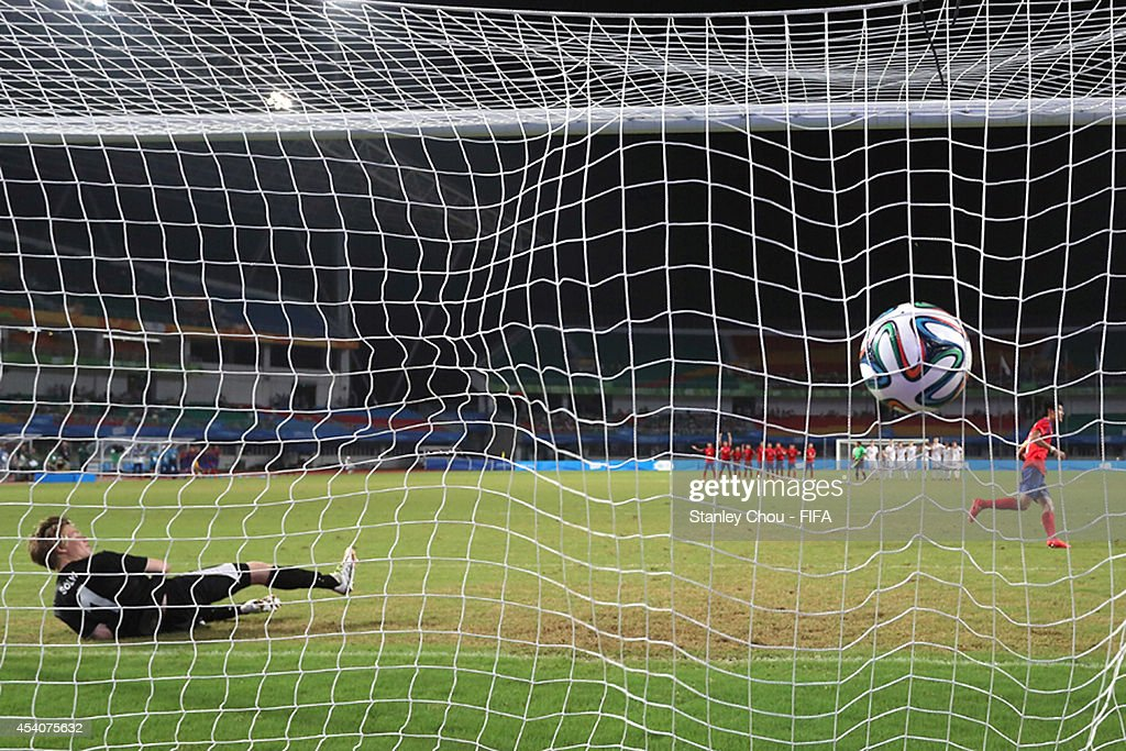 Lee Sangsu of Korea Republic scores against Solvi Bjornsson of Iceland in the penalty shoot out after full time 1-1 draw during the 2014 FIFA Boys Summer Youth Olympic Football Tournament Semi Final match between Korea Republic and Iceland at Jiangning Sports Centre Stadium on August 24, 2014 in Nanjing, China.