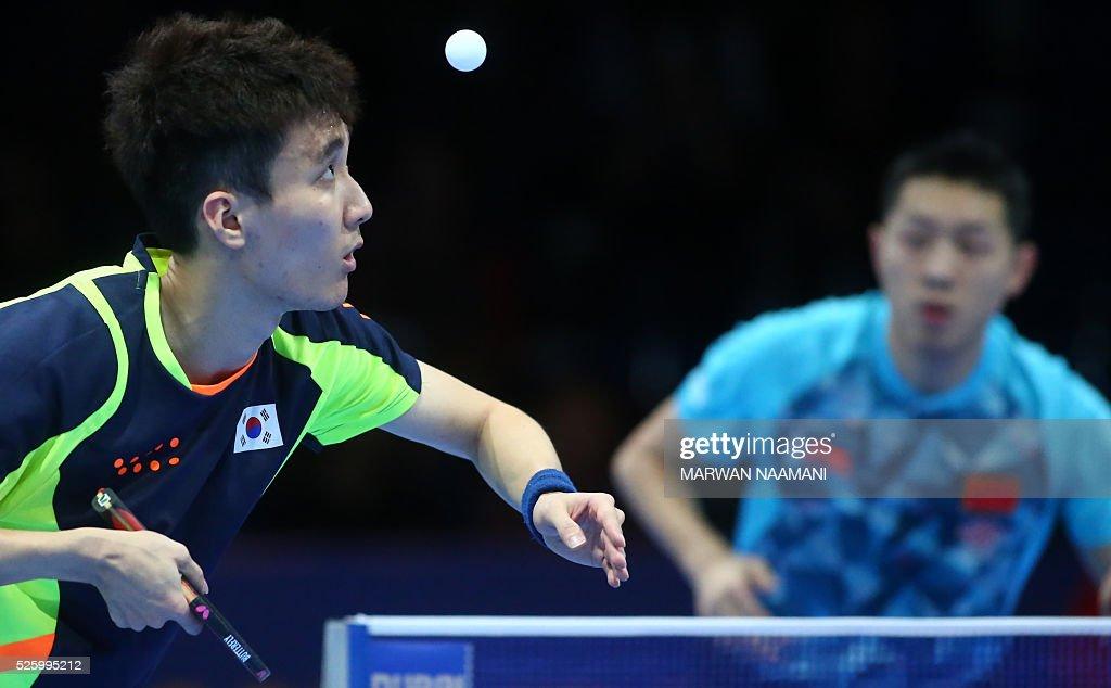 Lee Sangsu (L) of Korea returns the ball to Xu Xin of China during their men's singles quarter final table tennis match in the ITTF Nakheel Table Tennis Asian Cup, in Dubai, on April 29, 2016. / AFP / MARWAN