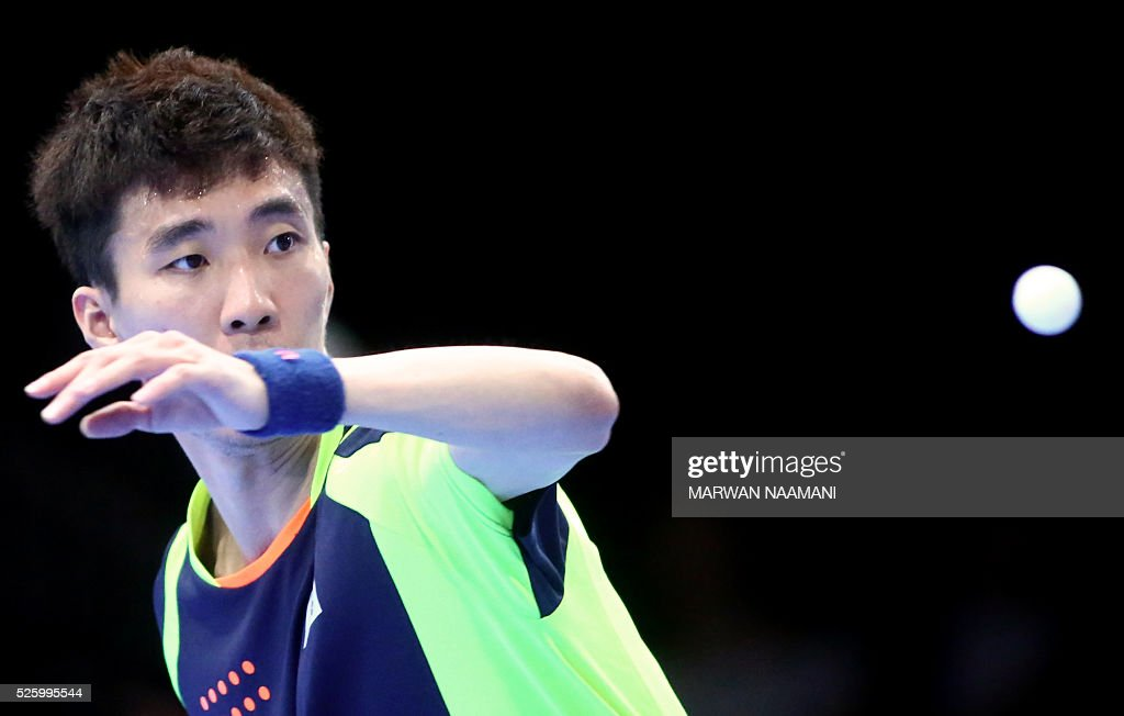 Lee Sangsu of Korea returns the ball to Xu Xin of China during their men's singles quarter final table tennis match in the ITTF Nakheel Table Tennis Asian Cup, in Dubai, on April 29, 2016. / AFP / MARWAN