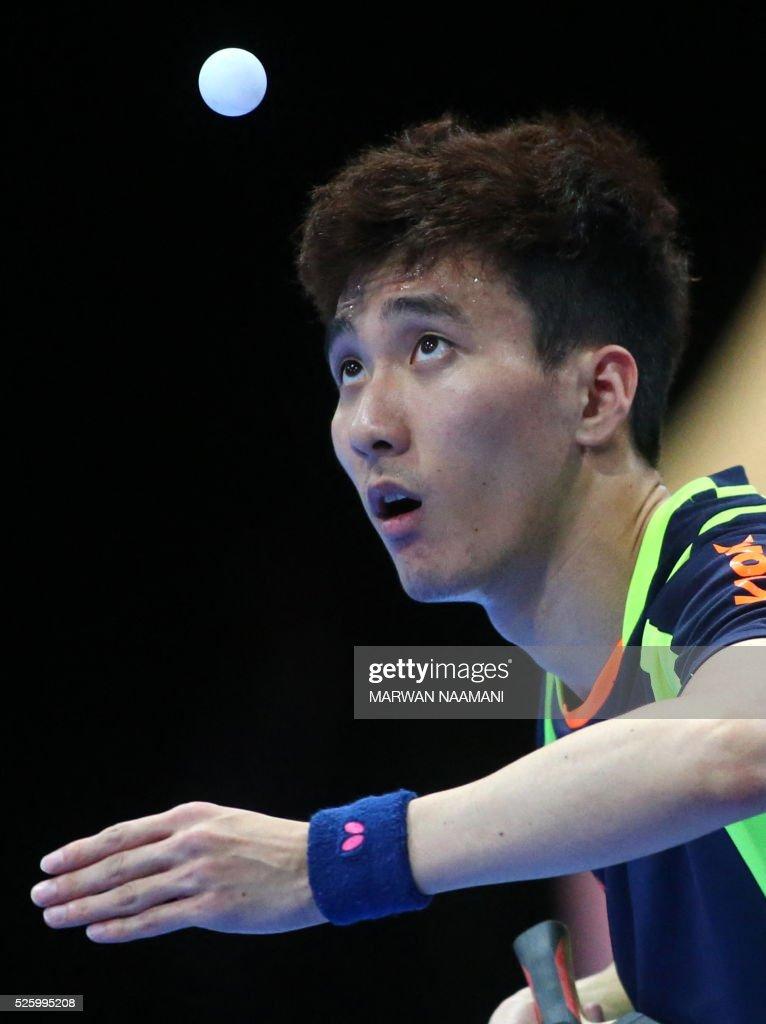 Lee Sangsu of Korea serves the ball to Xu Xin of China during their men's singles quarter final table tennis match in the ITTF Nakheel Table Tennis Asian Cup, in Dubai, on April 29, 2016. / AFP / MARWAN