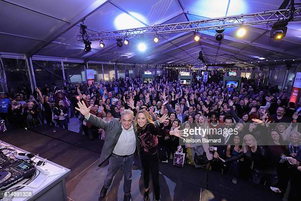 Lee Schrager New York City Wine Food Festival Founder and Director and Giada De Laurentiis pose for an images with the guests of Barilla's Italian...