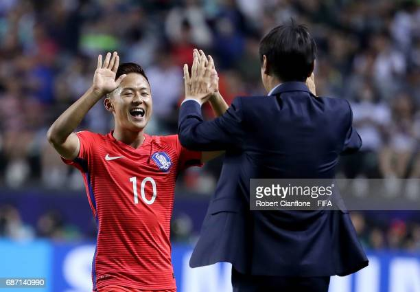 Lee Seungwoo of Korea Republic celebrates with Korea Republic coach Shin Taeyong after scoring a goal during the FIFA U20 World Cup Korea Republic...