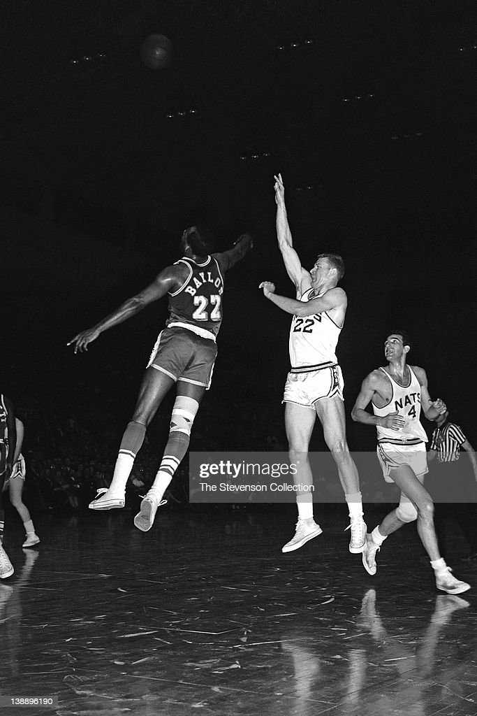 Lee Shaffer of the Syracuse Nationals shoots against Elgin Baylor of the Los Angeles Lakers circa 1962 at the Onondaga War Memorial Arena in Syracuse...