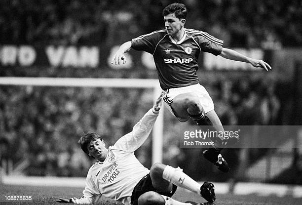 Lee Sharpe of Manchester United jumps over the challenge of Matthew Le Tissier of Southampton during the Manchester United v Southampton Division 1...