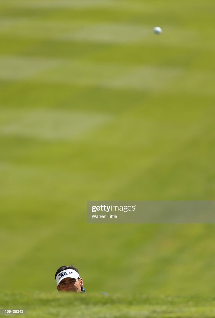 Lee Slattery of England chips onto the first hole during the third round of the BMW PGA Championship on the West Course at Wentworth on May 25, 2013 in Virginia Water, England.