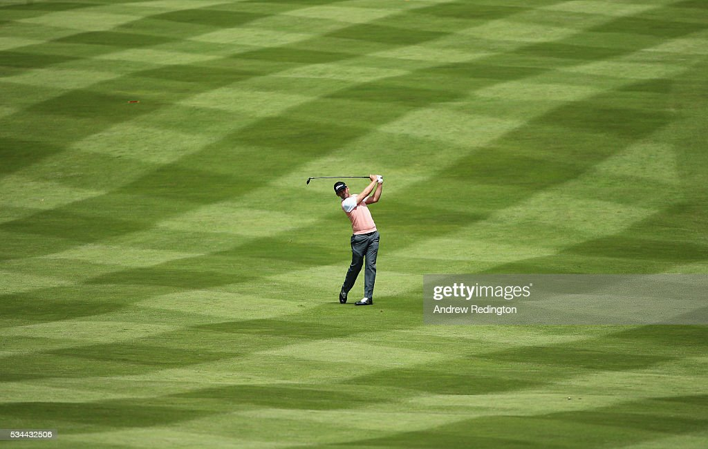 <a gi-track='captionPersonalityLinkClicked' href=/galleries/search?phrase=Lee+Slattery&family=editorial&specificpeople=178304 ng-click='$event.stopPropagation()'>Lee Slattery</a> of England hits his 2nd shot on the 4th hole during day one of the BMW PGA Championship at Wentworth on May 26, 2016 in Virginia Water, England.