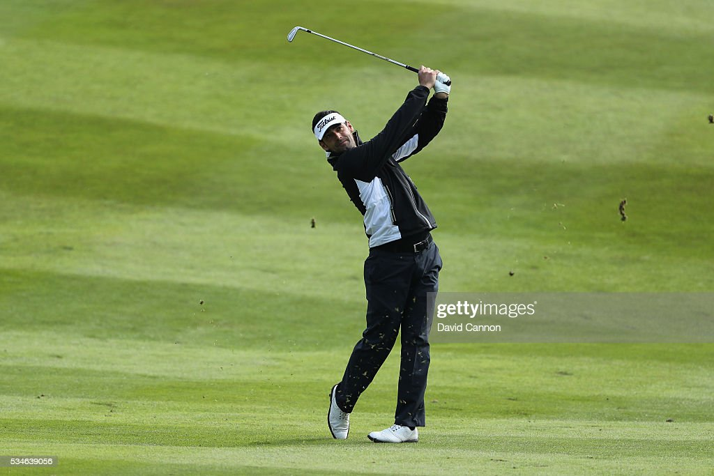 Lee Slattery of England hits his 2nd shot on the 7th hole during day two of the BMW PGA Championship at Wentworth on May 27, 2016 in Virginia Water, England.