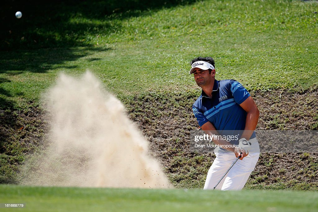 Lee Slattery of England hits out of the bunker for his third shot on the 6th hole during Day One of the Africa Open at East London Golf Club on February 14, 2013 in East London, South Africa.