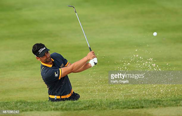 Lee Slattery of England plays his third shot out of a bunker on the eighth hole on day four of the M2M Russian Open at Skolkovo Golf Club on...