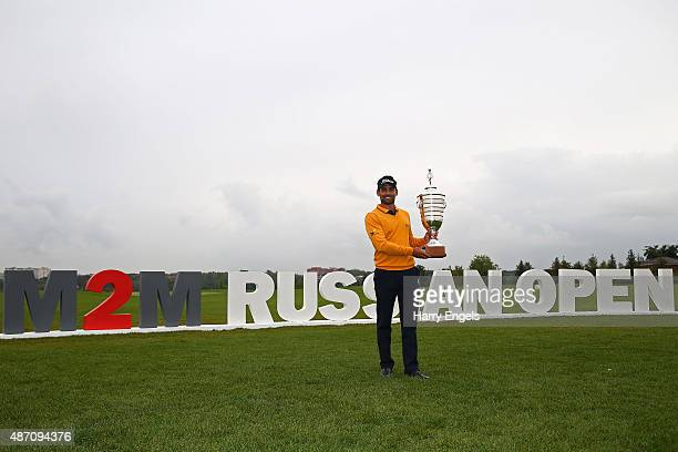 Lee Slattery of England poses for photographs with the trophy after winning the M2M Russian Open at Skolkovo Golf Club on September 6 2015 in Moscow...
