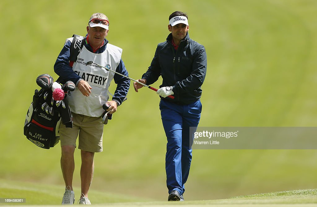Lee Slattery of England walks up the first fairway during the third round of the BMW PGA Championship on the West Course at Wentworth on May 25, 2013 in Virginia Water, England.
