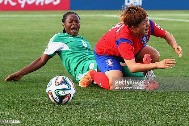 Lee Sodam of Korea Republic is challenged by Sarah Nnodim of Nigeria during the FIFA U20 Women's World Cup Canada 2014 group C match between Korea...