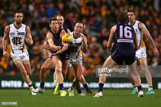 Lee Spurr of the Dockers handballs during the round 18 AFL match between the Fremantle Dockers and the Hawthorn Hawks at Domain Stadium on July 22...