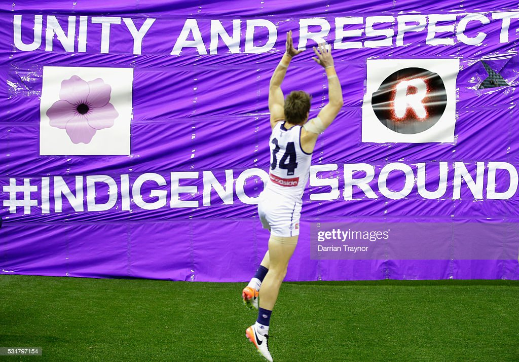 Lee Spurr of the Dockers prrepars to run through the Fremantle banner before the round 10 AFL match between the St Kilda Saints and the Fremantle Dockers at Etihad Stadium on May 28, 2016 in Melbourne, Australia.