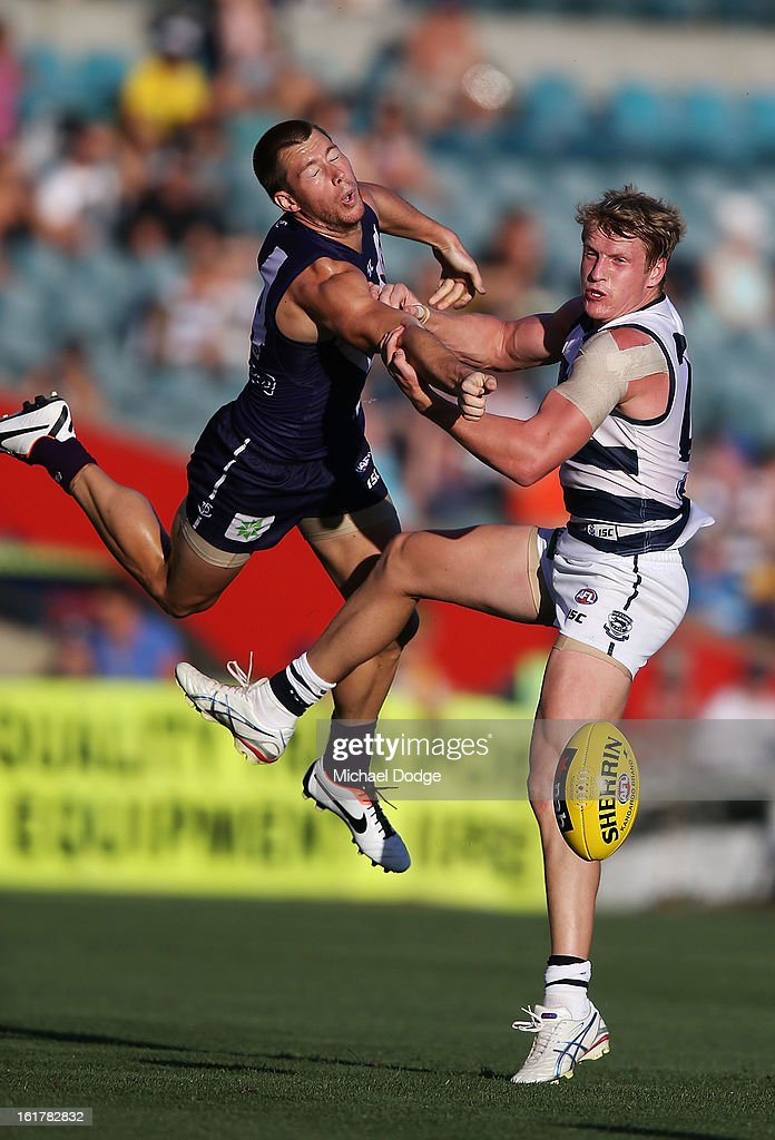 Lee Spurr of the Fremantle Dockers (L) contests for the ball against Josh Caddy of the Geelong Cats during the round one NAB Cup AFL match between the Fremantle Dockers and the Geelong Cats at Patersons Stadium on February 16, 2013 in Perth, Australia.