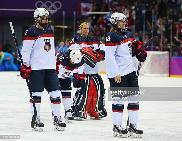 Lee Stecklein Kelli Stack Brianne McLaughlin and Lyndsey Fry of the United States react after losing 32 to Canada in overtime during the Ice Hockey...