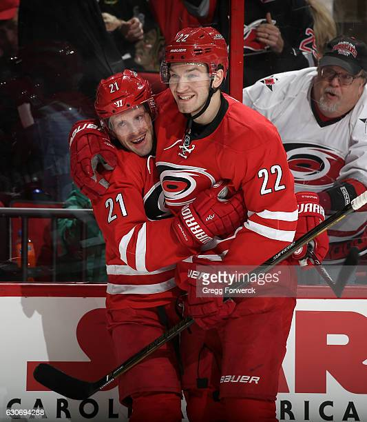 Lee Stempniak of the Carolina Hurricanes is congratulated by teammate Brett Pesce after scoring a first period goal during an NHL game against the...