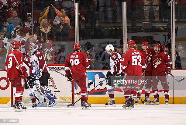 Lee Stempniak of the Phoenix Coyotes celebrates with teammates Keith Yandle Vernon Fiddler Derek Morris and Lauri Korpikoski after Stempniak scored a...