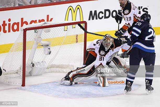 Lee Stempniak of the Winnipeg Jets scores a goal against Frederik Andersen of the Anaheim Ducks in firstperiod action in Game Three of the Western...