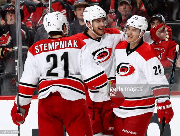 Lee StempniakNoah Hanifin of the Carolina Hurricanes congratulate teammate Sebastian Aho after he scored in the third period against the New Jersey...