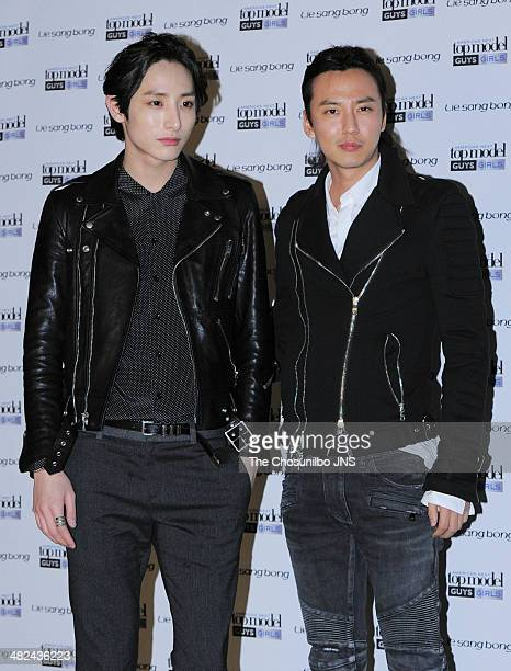 Lee SuHyuk and Kim NamGil pose for photographs during the America's Next Top Model finale show 'Lie SangBong Collection' at Floating Island on April...