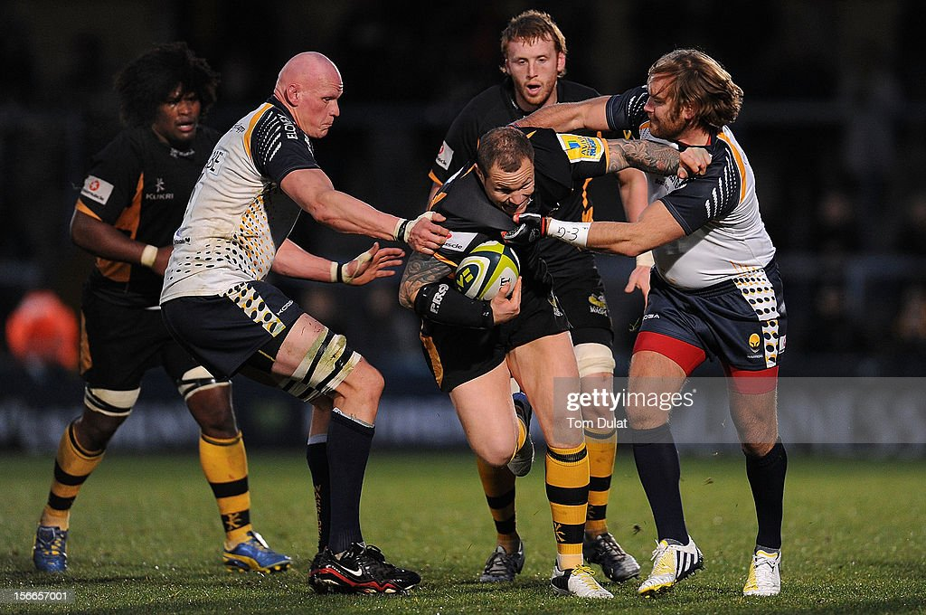 <a gi-track='captionPersonalityLinkClicked' href=/galleries/search?phrase=Lee+Thomas+-+Rugbyer&family=editorial&specificpeople=15152114 ng-click='$event.stopPropagation()'>Lee Thomas</a> of London Wasps is tackled by <a gi-track='captionPersonalityLinkClicked' href=/galleries/search?phrase=Craig+Gillies&family=editorial&specificpeople=709991 ng-click='$event.stopPropagation()'>Craig Gillies</a> (L) and <a gi-track='captionPersonalityLinkClicked' href=/galleries/search?phrase=Andy+Goode&family=editorial&specificpeople=211564 ng-click='$event.stopPropagation()'>Andy Goode</a> (R) of Worcester Warriors during the LV= Cup match between London Wasps and Worcester Warriors at Adams Park on November 18, 2012 in High Wycombe, England.