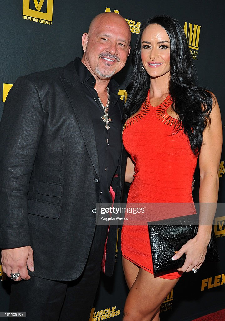 Lee Thompson (L) and guest arrive at the Los Angeles premiere of 'GENERATION IRON' at Chinese 6 Theater Hollywood on September 18, 2013 in Hollywood, California.