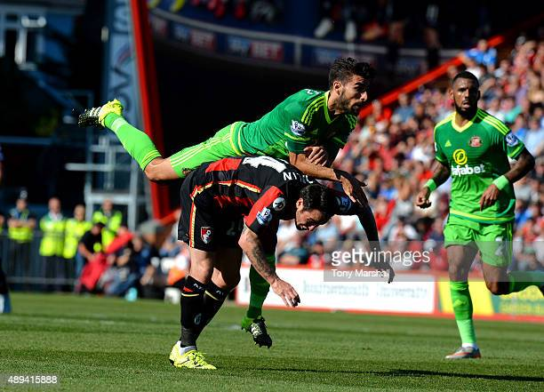 Lee Tomlin of AFC Bournemouth is tackled by Jordi Gomez of Sunderland during the Barclays Premier League match between AFC Bournemouth and Sunderland...