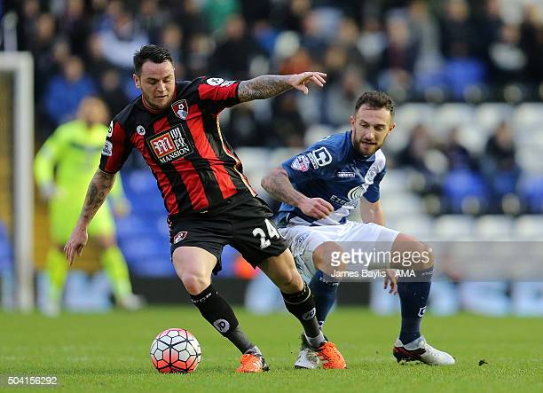 Lee Tomlin of Bournemouth and Simon Francis of Bournemouth in action during The Emirates FA Cup match between Birmingham City and AFC Bournemouth at...
