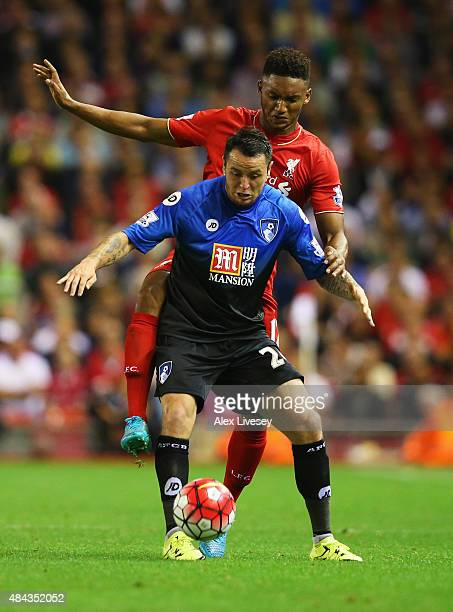 Lee Tomlin of Bournemouth holds off Joe Gomez of Liverpool during the Barclays Premier League match between Liverpool and AFC Bournemouth at Anfield...