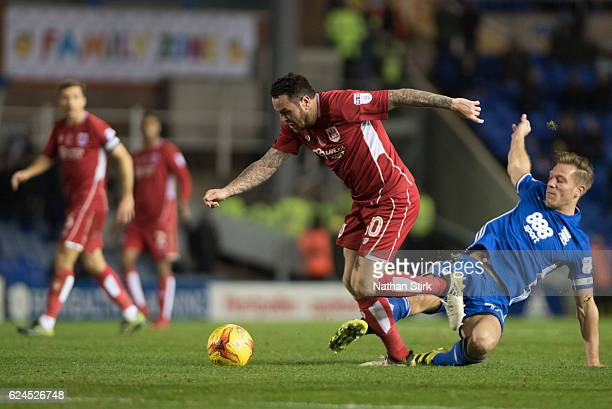 Lee Tomlin of Bristol City and Stephen Gleeson of Birmingham City in action during the Sky Bet Championship match between Birmingham City and Bristol...