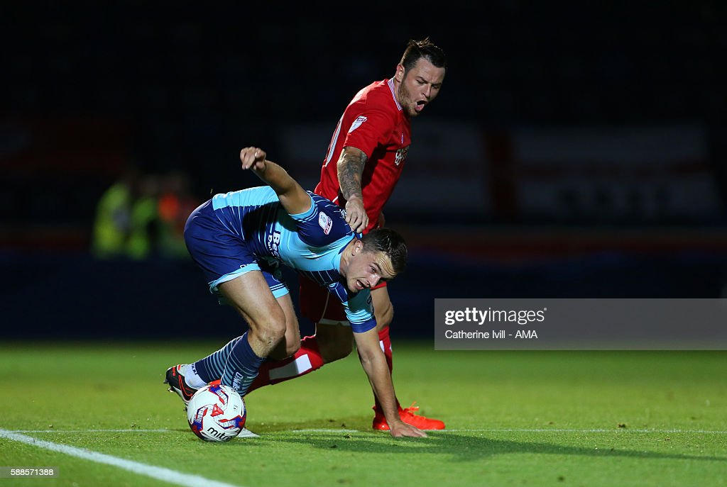 Lee Tomlin of Bristol City and Stephen McGinn of Wycombe Wanderers during the EFL Cup match between Wycombe Wanderers and Bristol City at Adams Park...