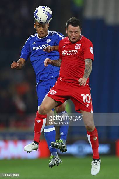 Lee Tomlin of Bristol City is challenged by Lee Peltier of Cardiff during the Sky Bet Championship match between Cardiff City and Bristol City at...