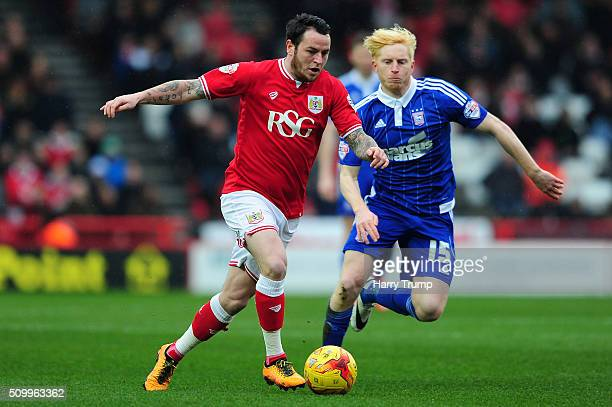 Lee Tomlin of Bristol City is tackled by Ben Pringle of Ipswich Town during the Sky Bet Championship match between Bristol City and Ipswich Town at...