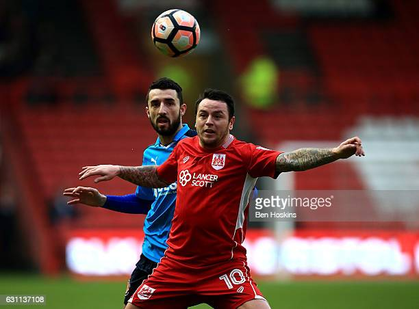 Lee Tomlin of Bristol holds off pressure from Conor McLaughlin of Fleetwood during The Emirates FA Cup Third Round match between Bristol City and...