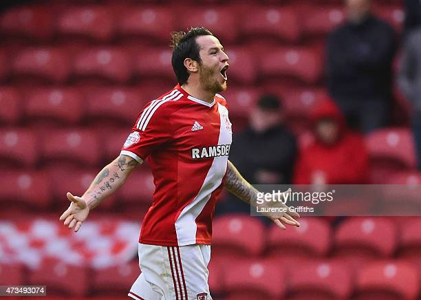 Lee Tomlin of Middlesbrough celebrates as he scores their first goal during the Sky Bet Championship Playoff semi final second leg match between...